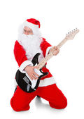 Portrait of a santa playing guitar — Stock Photo