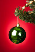 Green Bauble On Christmas Tree — Stock Photo