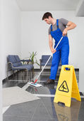 Man Cleaning The Floor — Stock Photo