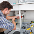 Plumber Fixing Sink In Kitchen — Stock Photo
