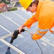 Engineer Adjusting Solar Panels — Stockfoto