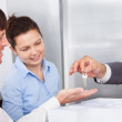 Person Giving Keys To Man — Stock Photo