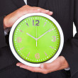Businessman Holding Clock — Stock Photo