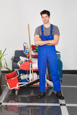 Young Man With Cleaning Equipment — Stock Photo