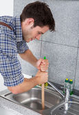 Young Man With Plunger — Stock Photo