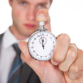 Businessman Holding Stopwatch — Stock Photo