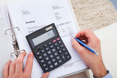 Young Man With Documents And Calculator — Stock Photo