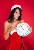 Pretty Woman In Santa Claus Costume Showing Clock — Stock Photo