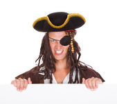 Pirate Holding Placard In Mouth — Stock Photo