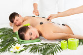 Couple Having A Hot Stone Massage — Stock Photo