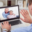 Stock Photo: MVideo Conferencing On Laptop