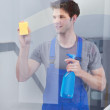 Cleaner Cleaning The Door Glass — Stock Photo #35015711