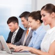 Businesspeople In A Row Working Together At Office — Stock Photo
