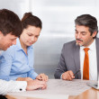 Broker Explaining To Young Couple — Stock Photo