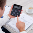 BusinessmUsing Calculator — Stock Photo #35016441