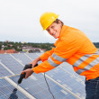 Engineer Adjusting Solar Panels — Stock Photo
