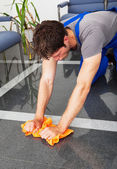 Man Cleaning With Duster — Stock Photo