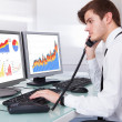 Stock Photo: Stock Broker Working At Office