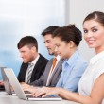 Businesspeople Using Laptop — Stock Photo