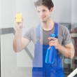 Cleaner Cleaning The Door Glass — Stock Photo #35620581