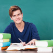 Young Man Studying In Classroom — Stock Photo #35620723