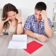 Worried Couple Reading Paper — Stock Photo #35620933