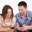 Happy Couple Using Cellphone — Stock Photo #35621071