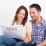 Couple Reading Newspaper — Stock Photo #35621329
