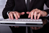 Businessman's Hand Typing On Keyboard — Stock Photo
