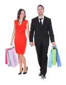 Happy Young Couple Holding Shopping Bags — Stock Photo