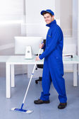 Male Worker Cleaning Floor — Stock Photo