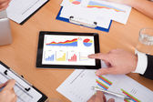 Businesspeople Pointing On Digital Tablet — Stock Photo