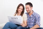 Couple Reading Newspaper — Stock Photo