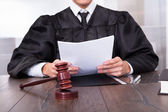 Judge Holding Documents — Stock Photo