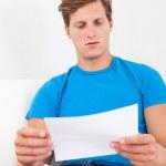 Shocked Man Holding Paper — Stock Photo #36128839