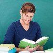 Young Man Studying In Classroom — Stock Photo #36129607