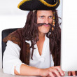 Pirate Using Computer — Stock Photo