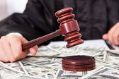 Judge Hitting Mallet On Dollar — Stock Photo