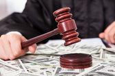 Judge Hitting Mallet On Dollar — Stock Photo