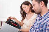 Man And Woman Looking At Couples Picture — Stock Photo