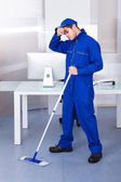 Tired Man Cleaning Floor — Stock Photo