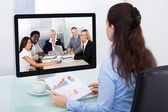 Businesswoman Watching Video Conference — Stock Photo
