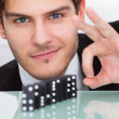 Businessman Playing Domino — Stock Photo
