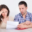 Worried Couple Reading Paper — Stock Photo