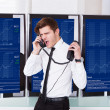 Angry Stock Broker Talking On Telephone — Stock Photo #37034185