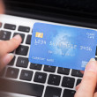 Person Holding Credit Card Using Laptop — Stockfoto