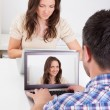 Man Sitting In Front Of Woman Looking At Her Photo — Stock Photo