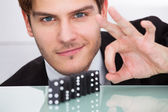 Businessman Playing Domino — Stock Photo