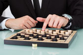 Businessman Playing Checkers — Foto de Stock