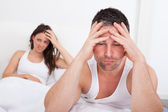 Frustrated Couple On Bed — Stock Photo
